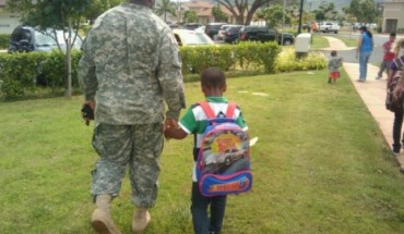 My husband walking my son to school the day before he deployed.