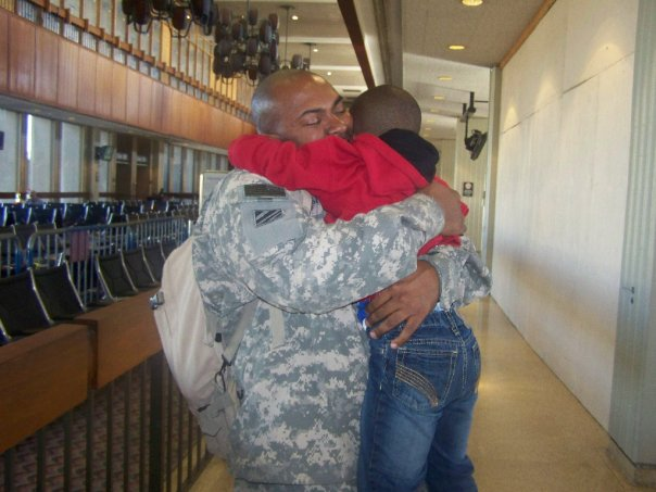 My son and his dad during my husband's arrival on a 14 day R&R from Iraq.