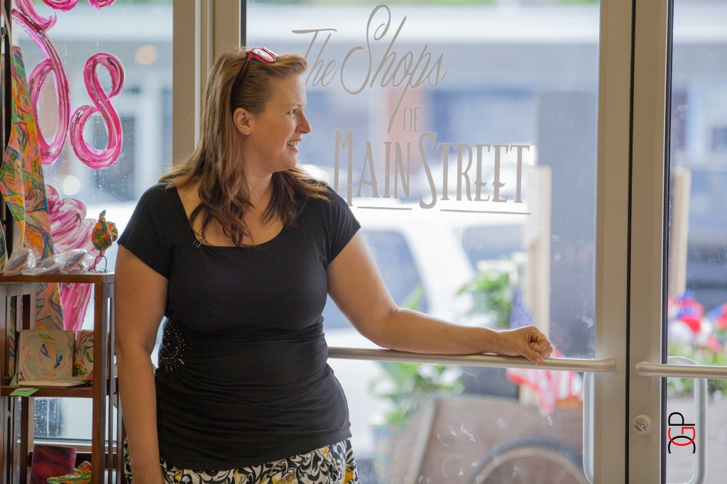 Shops of Main Shop Manager Gabrielle B. stands at door to greet guests . Chris Grissett Photography