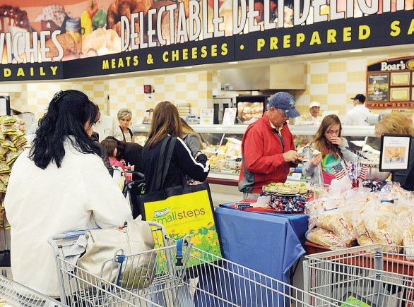 Photo Credit: Parker Rome, Fort Riley Public Affairs Shoppers sample foods near the bakery and deli March 13 following the ribbon-cutting ceremony for the Fort Riley Commissary.
